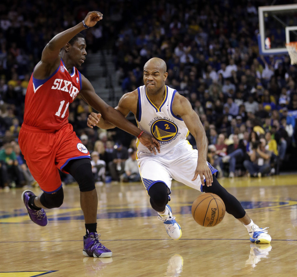 Golden State Warriors' Jarrett Jack (2) drives against Philadelphia 76ers' Jrue Holiday (11) during the second half of an NBA basketball game in Oakland, Calif., Friday, Dec. 28, 2012. Golden State won 96-89.  (AP Photo/Marcio Jose Sanchez)