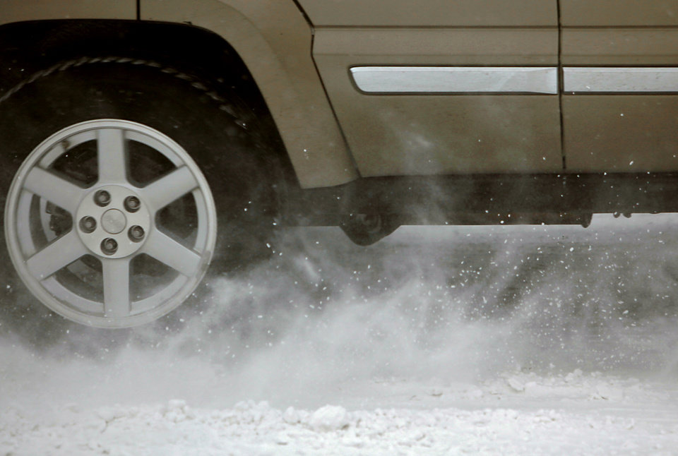 Photo - Snow swirls around tires of southbound traffic on Penn during a snow storm in The Village and Oklahoma City on Wednesday, Feb. 9, 2011. Photo by John Clanton, The Oklahoman
