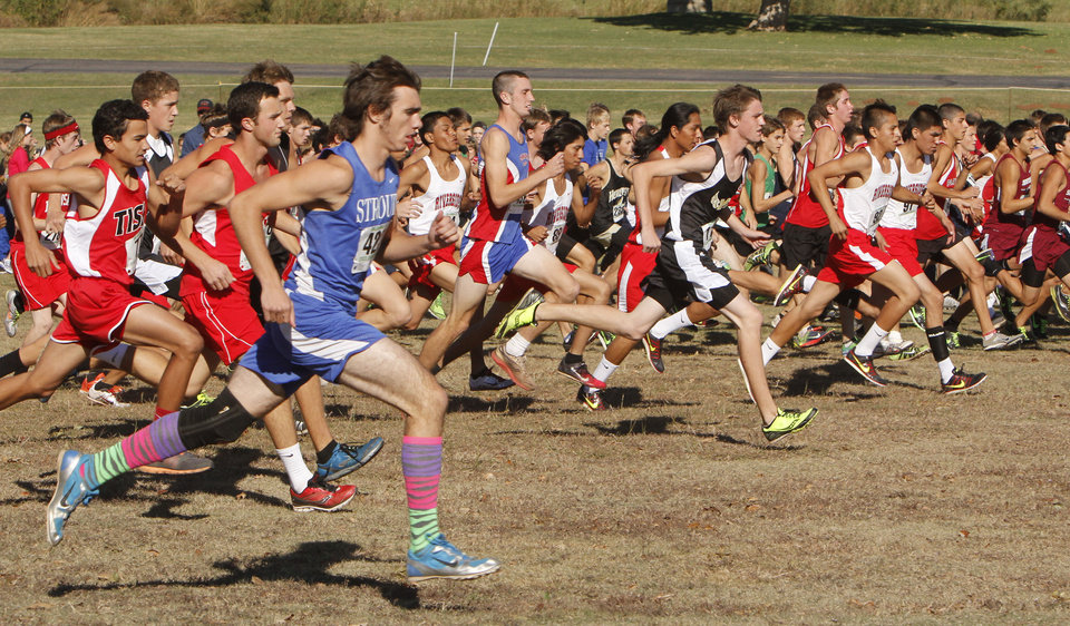 Photo - Class 3A runners begin their race during the boys State cross country meet at Gordon Cooper Vo-Tech in Shawnee, OK, Saturday, October 20, 2012,  By Paul Hellstern, The Oklahoman