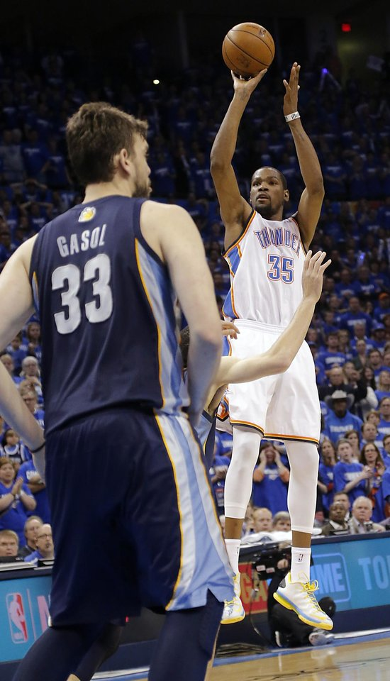 Oklahoma City's Kevin Durant (35) puts up the game winning shot for the 93-91 win over Memphis during the second round NBA playoff basketball game between the Oklahoma City Thunder and the Memphis Grizzlies at Chesapeake Energy Arena in Oklahoma City, Sunday, May 5, 2013. Photo by Chris Landsberger, The Oklahoman