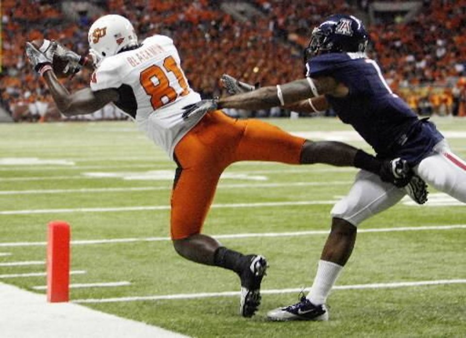 OSU's Justin Blackmon (81) makes a touchdown catch as Robert Golden (1) of Arizona defends in the third quarter during the Valero Alamo Bowl college football game between the Oklahoma State University Cowboys ( OSU) and the University of Arizona Wildcats at the Alamodome in San Antonio, Texas, Wednesday, December 29, 2010. OSU won, 36-10. Photo by Nate Billings