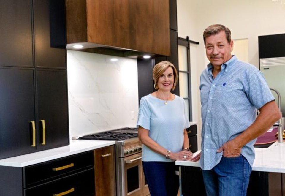 Photo -  Carrie and John Nail, of John Nail Homes, at 2229 Stone Mill Court, in Waters Edge at Stone Mill addition in Yukon, which they buillt as the builders' Project House for the Parade of Homes Fall Classic Saturday through Sept. 27.  [CHRIS LANDSBERGER/THE OKLAHOMAN]