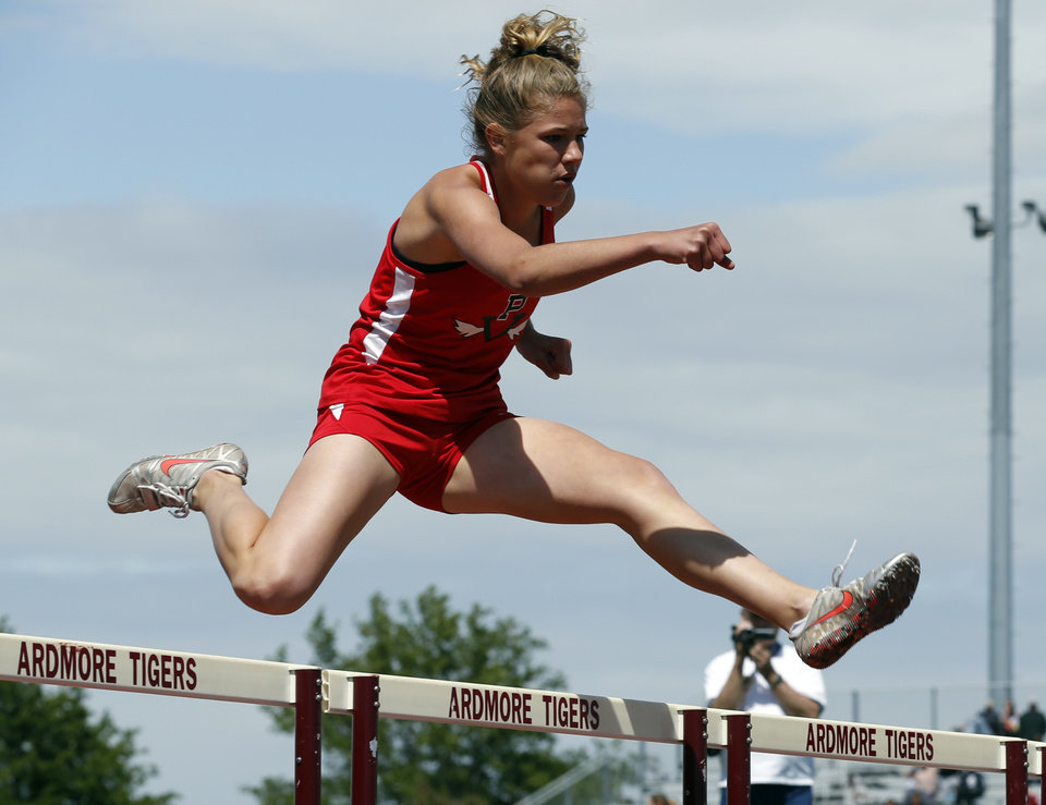 Photo - Pauls Valley freshman Claire Grimmett wins the 4A Girls 300 Meter Hurdles during the State 3A and 4A Track Meet on Saturday, May 4, 2013, in Ardmore, Okla.   Photo by Steve Sisney, The Oklahoman
