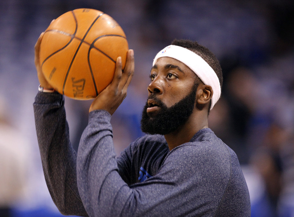 Oklahoma City's James Harden (13) warms up before game 3 of the Western Conference Finals of the NBA basketball playoffs between the Dallas Mavericks and the Oklahoma City Thunder at the OKC Arena in downtown Oklahoma City, Saturday, May 21, 2011. Photo by Sarah Phipps, The Oklahoman