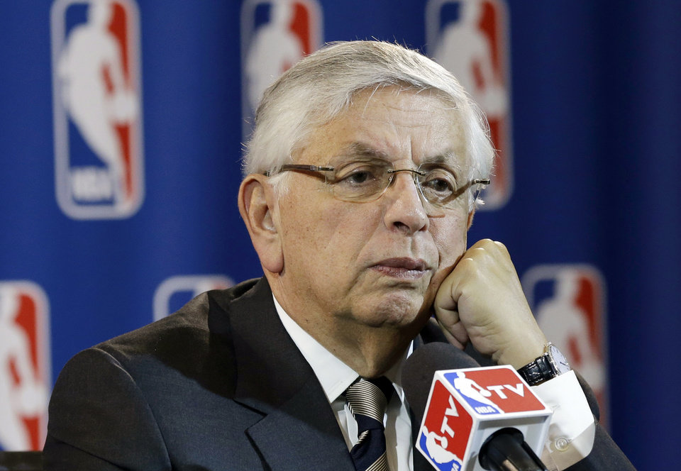 Photo - NBA commissioner David Stern takes a question from a reporter during a news conference following the Board of Governors meeting Wednesday, May 15, 2013, in Dallas. NBA owners voted Wednesday to reject the Kings' proposed move to Seattle, the latest in a long line of cities that have tried to land the franchise.   (AP Photo/Tony Gutierrez)