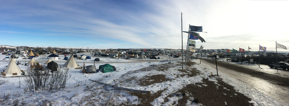 Photo -  Frigid winds blow through the Oceti Sakowin Camp on the Standing Rock Indian Reservation in North Dakota. [Photo by Graham Lee Brewer, The Oklahoman]