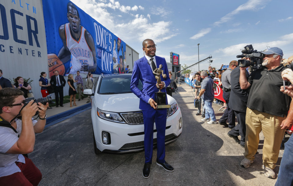Photo - Kevin Durant poses with the 2013-14 Kia NBA Basketball Most Value Player Award after a news conference announcing Durant as the winner of the award in Oklahoma City, Okla. on Tuesday, May 6, 2014. Photo by Chris Landsberger, The Oklahoman