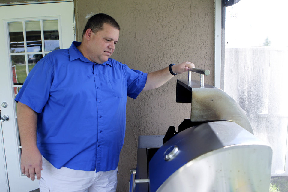 Photo -   In this Wednesday, July 25, 2012 photo, Travis Joyner relaxes on a day off from his job, at his home in Clermont, Fla. Joyner is a shop steward for Unite HERE! Local 362 who works at the Animal Kingdom Disney park. He likes President Barack Obama's job proposal and health plan and sees Republican presidential candidate, former Gov. Mitt Romney's economic ideas as a dangerous retread. (AP Photo/John Raoux)