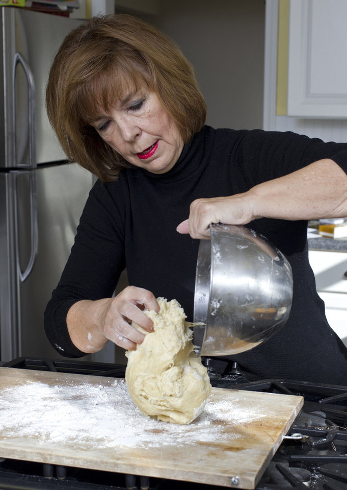Judith Fertig puts the dough on a floured surface for rolling and kneading. (Tammy Ljungblad/Kansas City Star/MCT)
