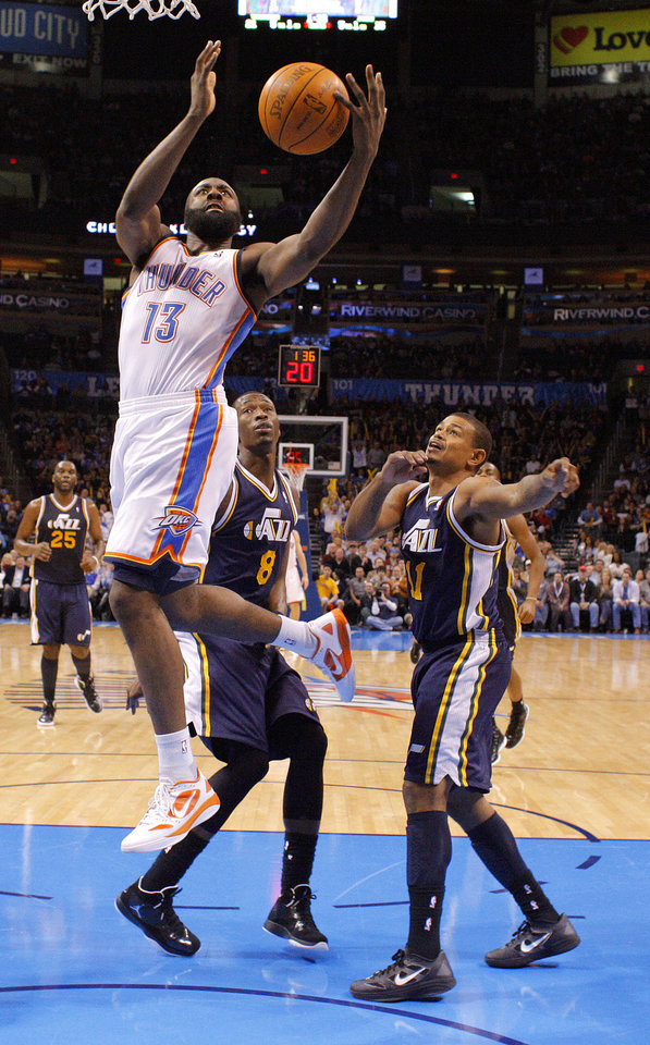 Photo - Oklahoma City's James Harden (13) goes past Utah's Josh Howard (8) and Earl Watson (11) during an NBA game between the Oklahoma City Thunder and the Utah Jazz at Chesapeake Energy Arena in Oklahoma CIty, Tuesday, Feb. 14, 2012. Photo by Bryan Terry, The Oklahoman