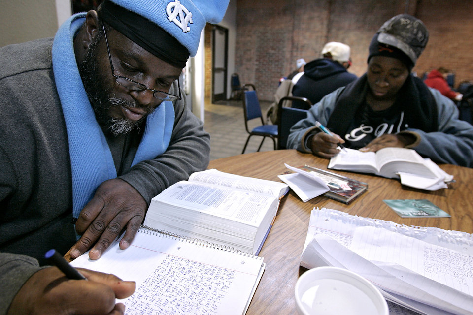 Photo - WINTER / COLD / WEATHER / ICE STORM: Tori Williams (left) and Bridgett Hodrick read their Bibles  inside the City Rescue Mission in Oklahoma City on Monday, Dec. 10, 2007. By John Clanton, The Oklahoman ORG XMIT: KOD