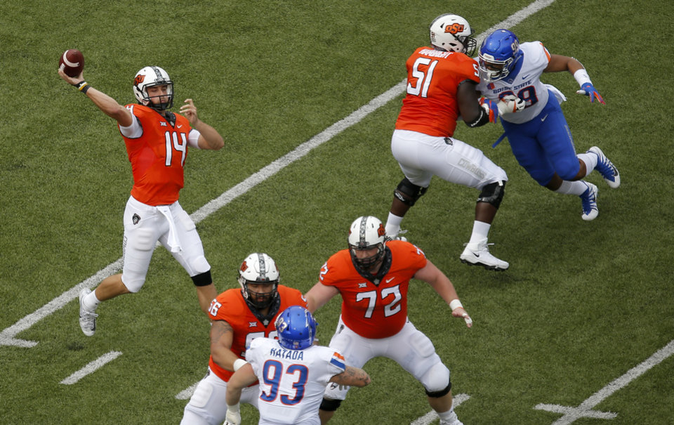 Photo -  Oklahoma State's Taylor Cornelius (14) throws a pass in the first quarter against Boise State on Sept. 15. OSU won 44-21. [Photo by Sarah Phipps, The Oklahoman]