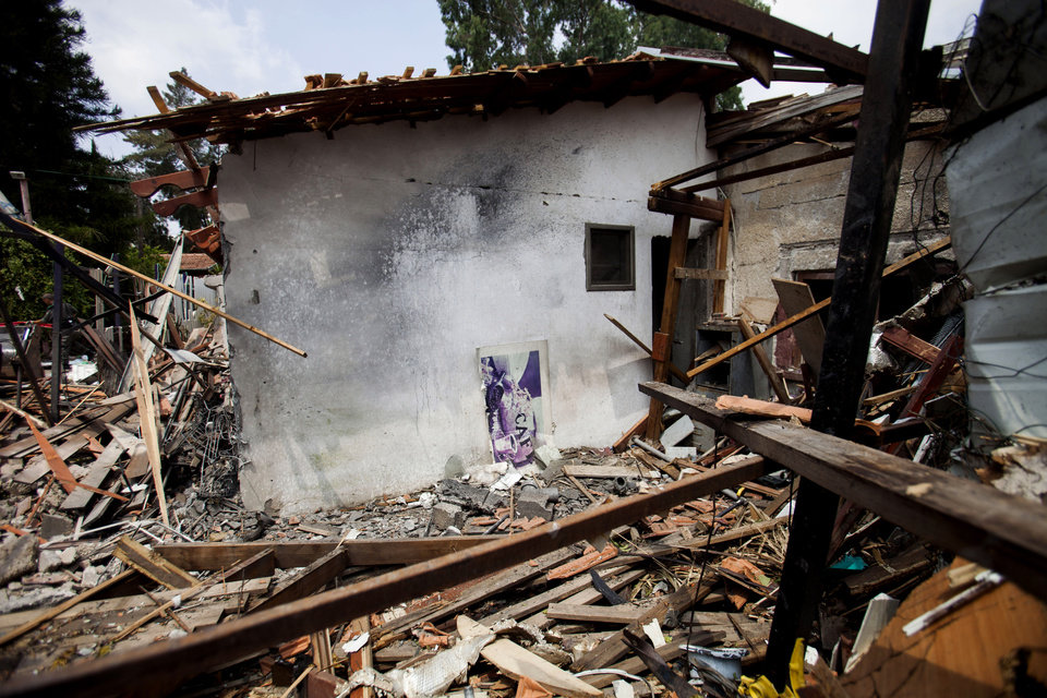 Photo - A destroyed house that was hit by a rocket fired by Palestinians militants from Gaza, in Yahud, a Tel Aviv suburb near the airport, central Israel, Tuesday, July 22, 2014. As a result, Delta Air Lines and U.S. Airlines decided to cancel their scheduled flights to Israel.(AP Photo/Dan Balilty)