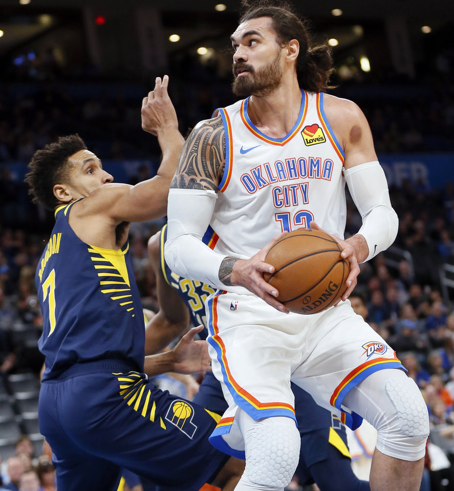 Photo - Oklahoma City's Steven Adams (12) works against Indiana's Malcolm Brogdon (7) in the first quarter during an NBA basketball game between the Indiana Pacers and the Oklahoma City Thunder at Chesapeake Energy Arena in Oklahoma City, Wednesday, Dec. 4, 2019. [Nate Billings/The Oklahoman]