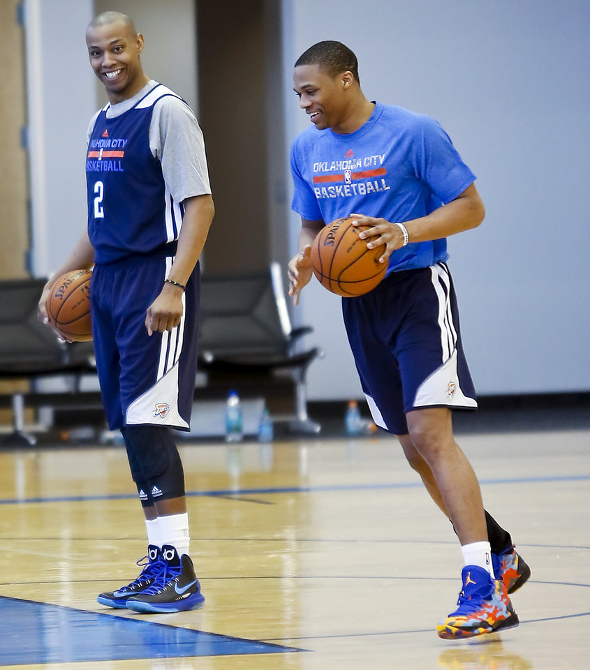 Photo - Caron Butler goes through shooting drills with Russell Westbrook talks as Bulter makes his first practice appearance with the Oklahoma City Thunder at the Oklahoma City Thunder practice facility in Oklahoma City, Okla. on Monday, March 3, 2014.  Photo by Chris Landsberger, The Oklahoman