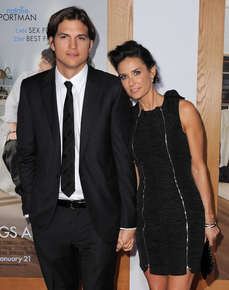 Photo - FILE - In this Jan. 11, 2011 file photo, actor Ashton Kutcher, left, and actress Demi Moore arrive at the