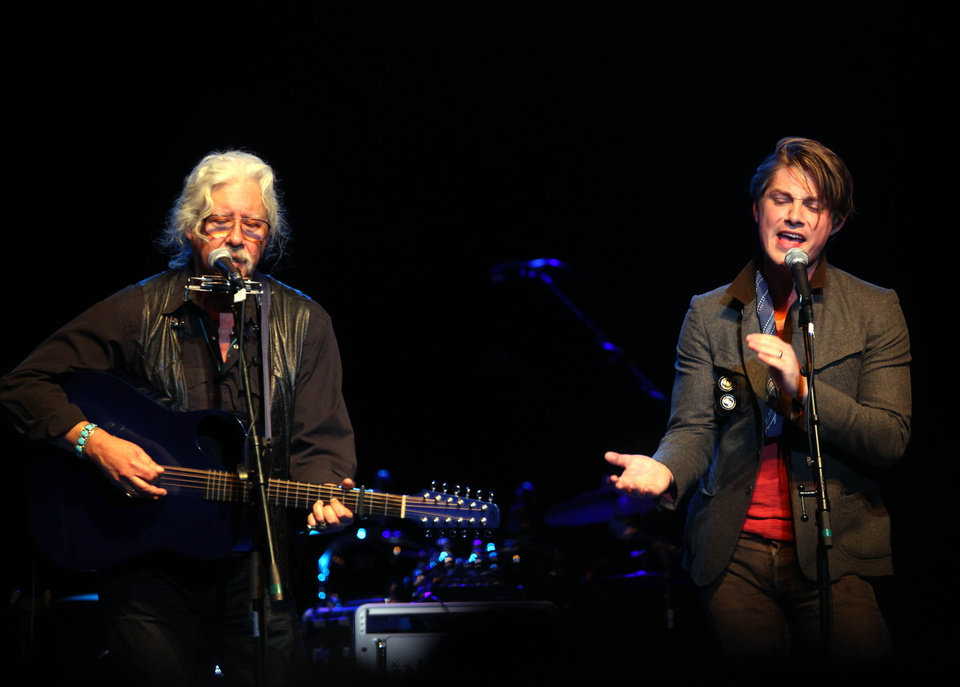 Arlo Guthrie peforms with Taylor Hanson during the Woody Guthrie Centennial Concert at the Brady Theater Saturday March 10, 2012. (AP Photo/Christopher Smith, Tulsa World) ORG XMIT: OKTUL103