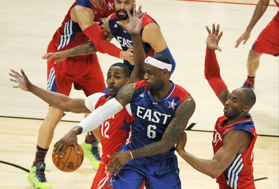East Team\'s LeBron James of the Miami Heat, drives against West Team\'s LaMarcus Aldridge of the Portland Trail Blazers and Kobe Bryant of the Los Angeles Lakers, right, during the first half of the NBA All-Star basketball game Sunday, Feb. 17, 2013, in Houston. (AP Photo/Pat Sullivan)
