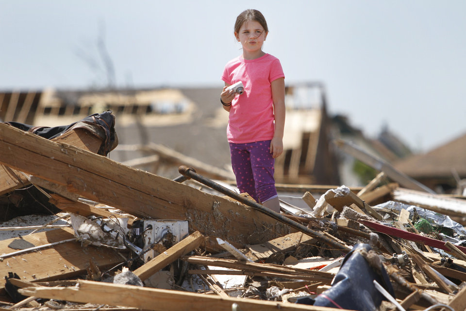 Lauren Matthews, 7 takes photos of her home on SW 146th in Oklahoma City, Wednesday May 22, 2013. Members of the Oklahoma City Lauren\'s home was hit by a tornado on Monday afternoon. Photo By Steve Gooch, The Oklahoman