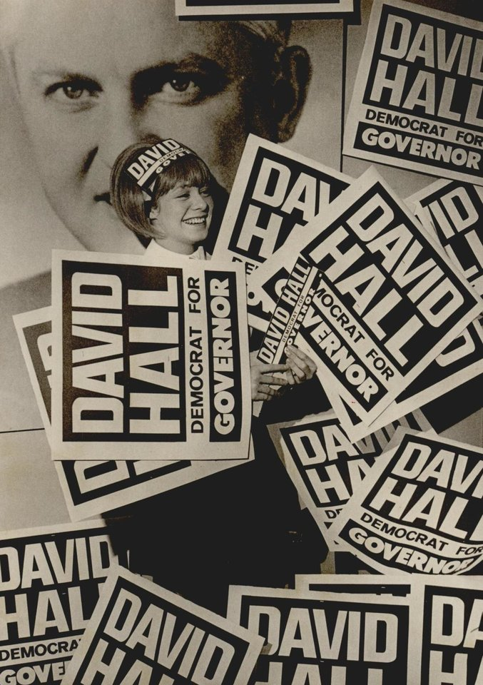 Photo - Nancy Glisan surrounded by David Hall signs at Hall's campaign headquarters in 1970. [Photo by Dave Pate, The Oklahoman Archives]