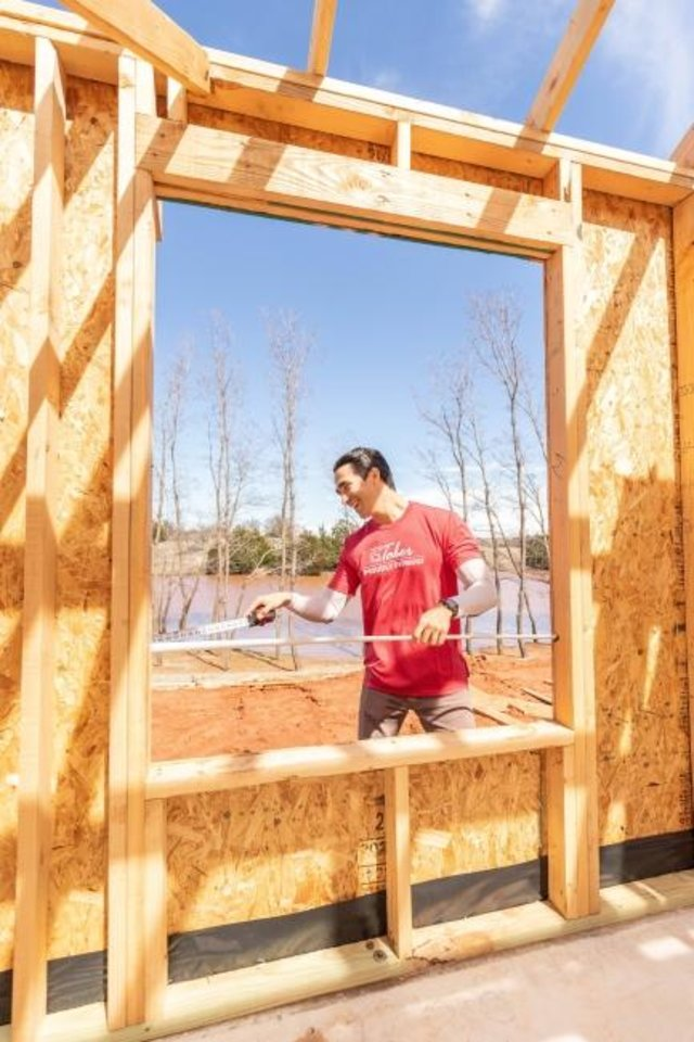 Photo -  Devon Streetman, construction superintendent for Homes By Taber in Delmer Lakes addition in Edmond, works on a home in the framing stage. [PHOTO PROVIDED]