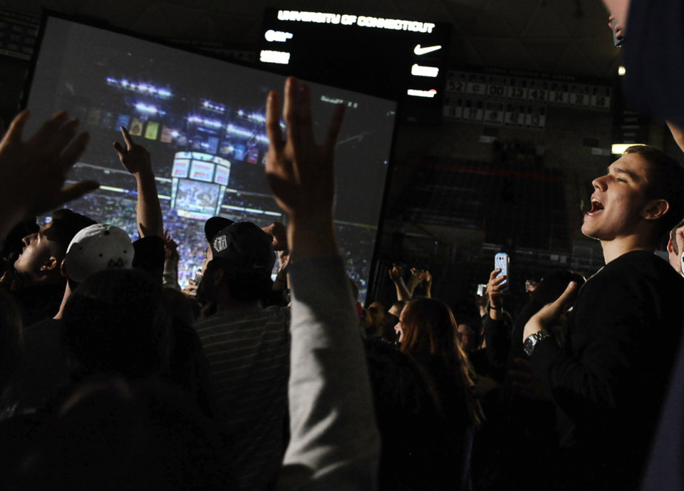 Photo - Connecticut fans celebrate after watching the broadcast of the team's 79-58 win over Notre Dame in the NCAA women's college basketball basketball tournament title game, Tuesday, April 8, 2014, in Storrs, Conn. (AP Photo/Jessica Hill)