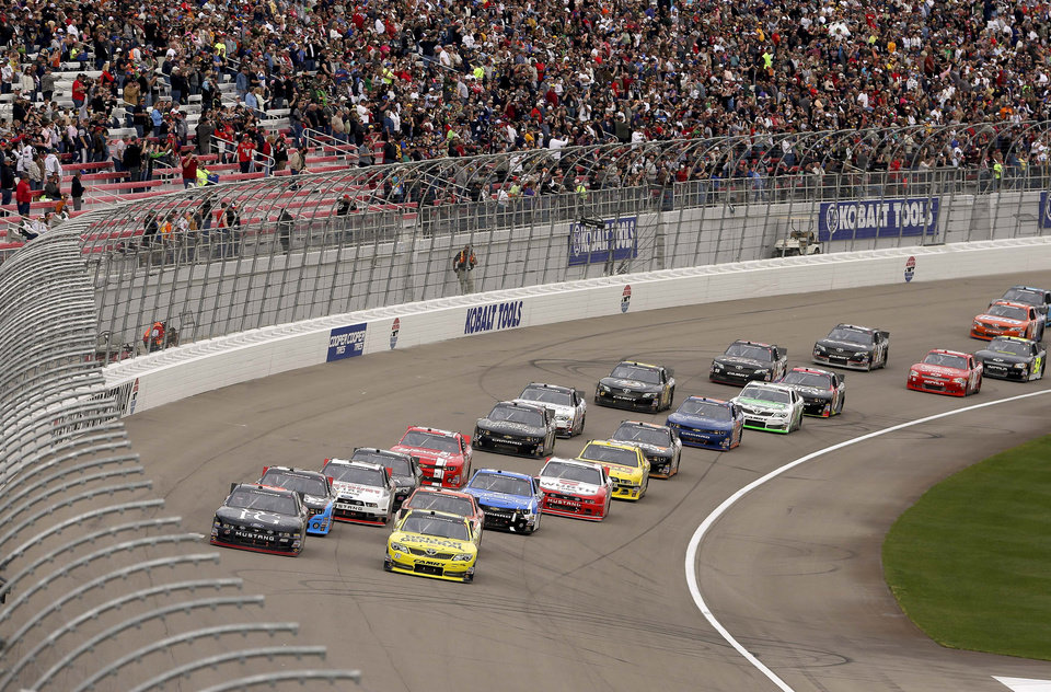 Drivers make their way around Turn 1 at the start of the NASCAR Nationwide Series auto race, Saturday, March 9, 2013, in Las Vegas. (AP Photo/Julie Jacobson)
