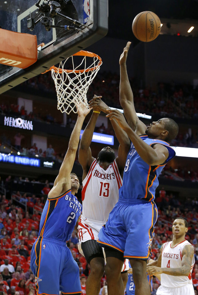 Photo - Oklahoma City's Thabo Sefolosha (2) and Oklahoma City's Serge Ibaka (9) defend Houston's James Harden (13) during Game 4 in the first round of the NBA playoffs between the Oklahoma City Thunder and the Houston Rockets at the Toyota Center in Houston, Texas,Sunday, April 29, 2013. Oklahoma City lost 105-103. Photo by Bryan Terry, The Oklahoman