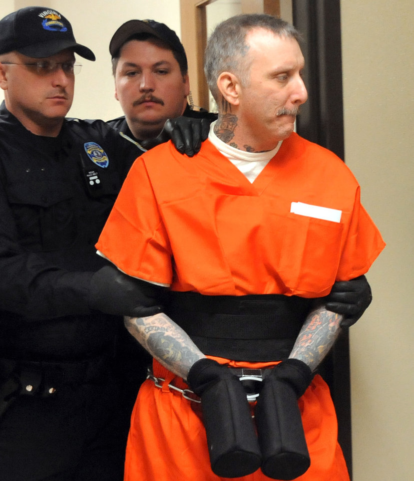 FILE - In this Tuesday Jan. 25. 2012 file photo, Robert Gleason Jr. is escorted into a Wise County courtroom in Wise, Va.  An execution date of Jan. 16, 2013 has been set for Gleason, who strangled two inmates in the state's highest security prisons and vowed to keep killing unless he was put to death.  (AP Photo/Bristol Herald Courier, David Crigger, File)