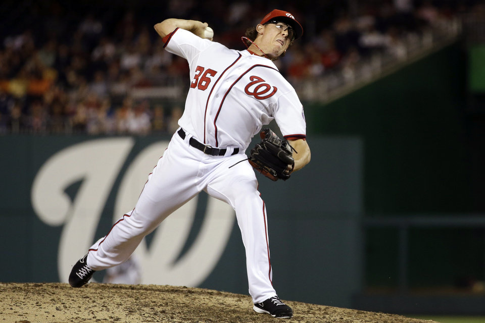 Photo -   Washington Nationals relief pitcher Tyler Clippard delivers against the Milwaukee Brewers during the ninth inning of a baseball game at Nationals Park in Washington, Friday, Sept. 21, 2012. The Brewers won 4-2. (AP Photo/Jacquelyn Martin)