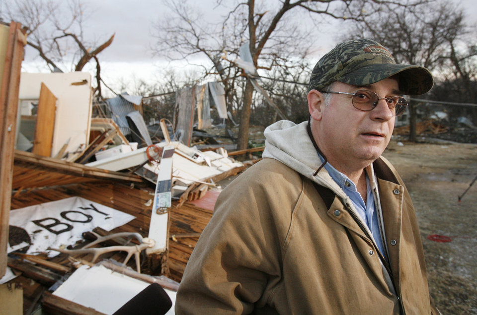 Photo - John Taliaferro sees the remains of his furniture store in first light after  Tuesday's deadly tornado in  Lone Grove, Okla. on Wednesday, Feb. 11, 2009.   Photo by Steve Sisney, The Oklahoman