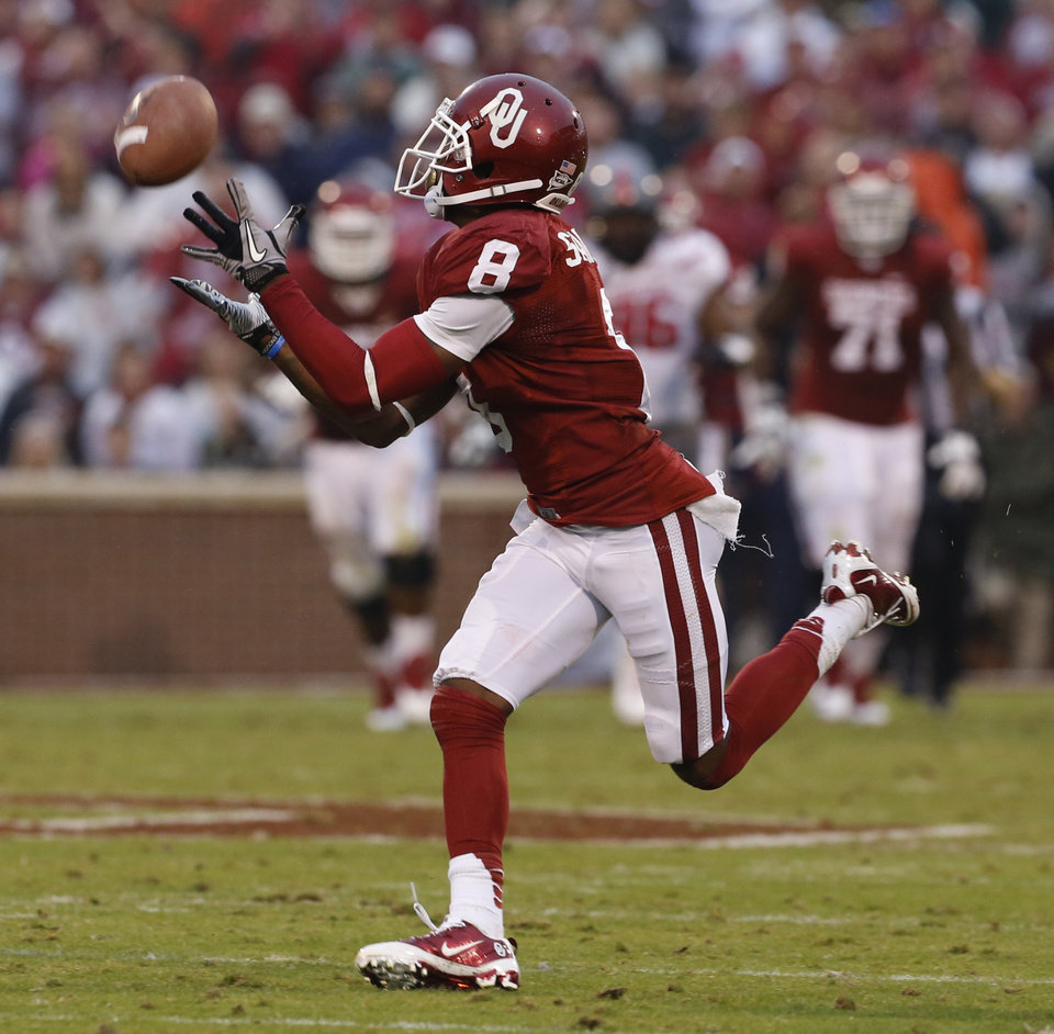 Oklahoma's Jalen Saunders (8) scores during a college football game between the University of Oklahoma Sooners (OU) and the Texas Tech Red Raiders at Gaylord Family-Oklahoma Memorial Stadium in Norman, Okla., on Saturday, Oct. 26, 2013. Photo by Steve Sisney, The Oklahoman