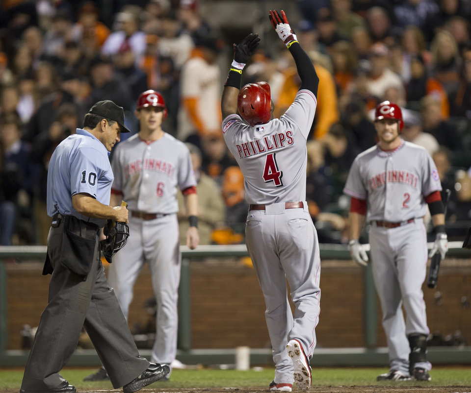 Cincinnati Reds second baseman Brandon Phillips (4) reacts to his two-run home run in Game 1 of baseball's National League Division Series against the San Francisco Giants on Saturday, Oct. 6, 2012, in San Francisco. (AP Photo/The Sacramento Bee, ) MAGS OUT; TV OUT (KCRA3, KXTV10, KOVR13, KUVS19, KMAZ31, KTXL40) MANDATORY CREDIT