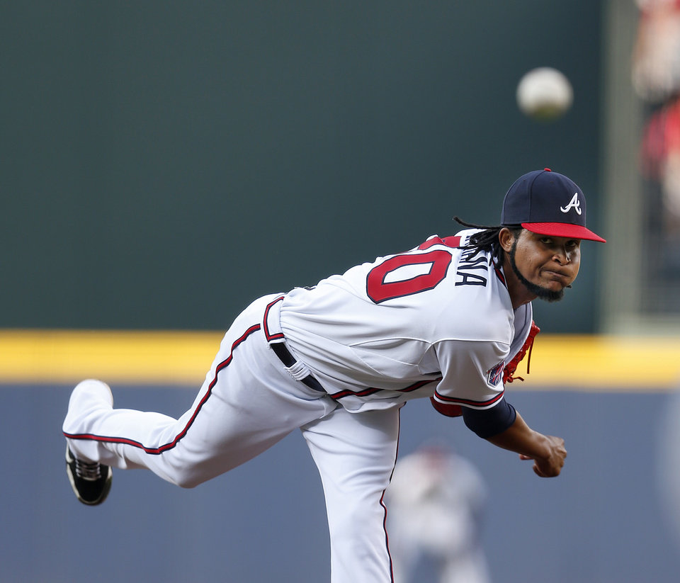 Photo - Atlanta Braves starting pitcher Ervin Santana works in the first inning of baseball game against the Miami Marlins  in Atlanta, Wednesday, July 23, 2014. Atlanta won 6-1. (AP Photo)