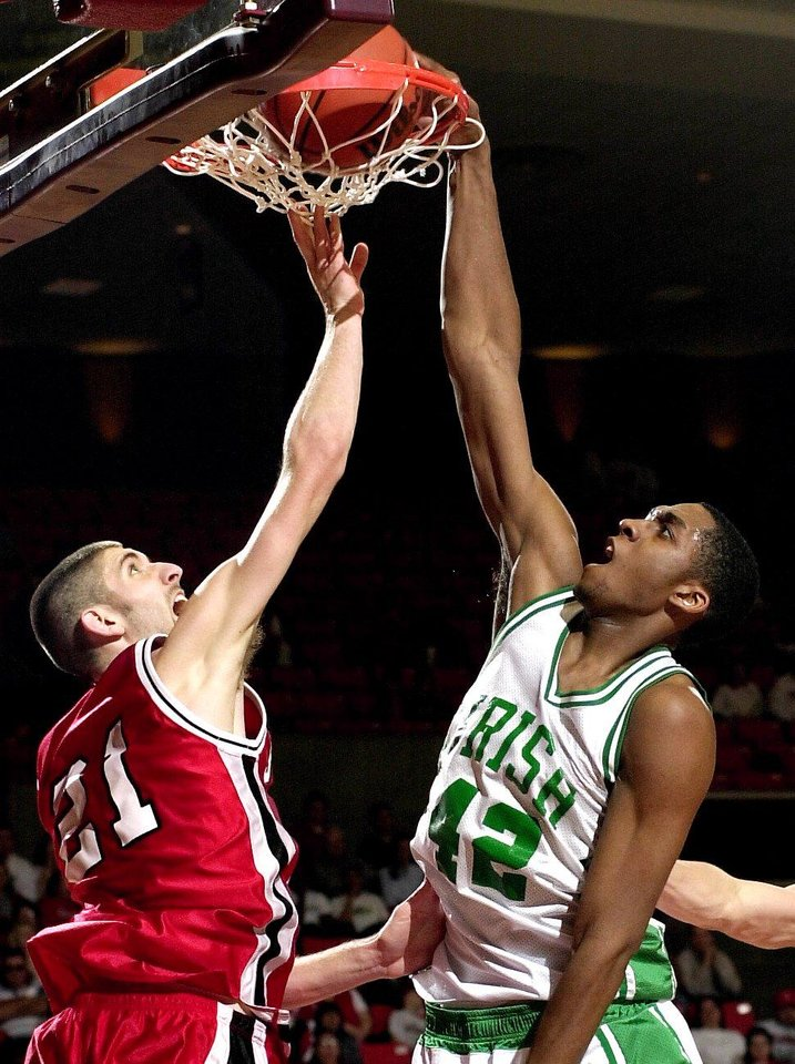 Photo - BISHOP MCGUINNESS #42 TERRENCE CRAWFORD DUNKS THE BALL ON STILWELL'S #21 CURTIS BRASHEAR IN SAT. CLASS 4A HIGH SCHOOL BASKETBALL STATE CHAMPIONSHIP GAME AT THE LLOYD NOBLE CENTER IN NORMAN.