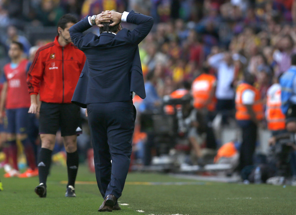 Photo - Barcelona's coach Gerardo Martino from Argentina reacts to an off sight goal during a Spanish La Liga soccer match between FC Barcelona and Atletico Madrid at the Camp Nou stadium in Barcelona, Spain, Saturday, May 17, 2014. (AP Photo/Emilio Morenatti)
