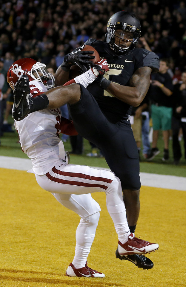 Baylor\'s Antwan Goodley (5) catches a touchdown pass beside Oklahoma\'s Stanvon Taylor (6) during an NCAA college football game between the University of Oklahoman (OU) Sooners and the Baylor Bears at Floyd Casey Stadium in Waco, Texas, Thursday, Nov. 7, 2013. Baylor won 41-12. Photo by Bryan Terry, The Oklahoman