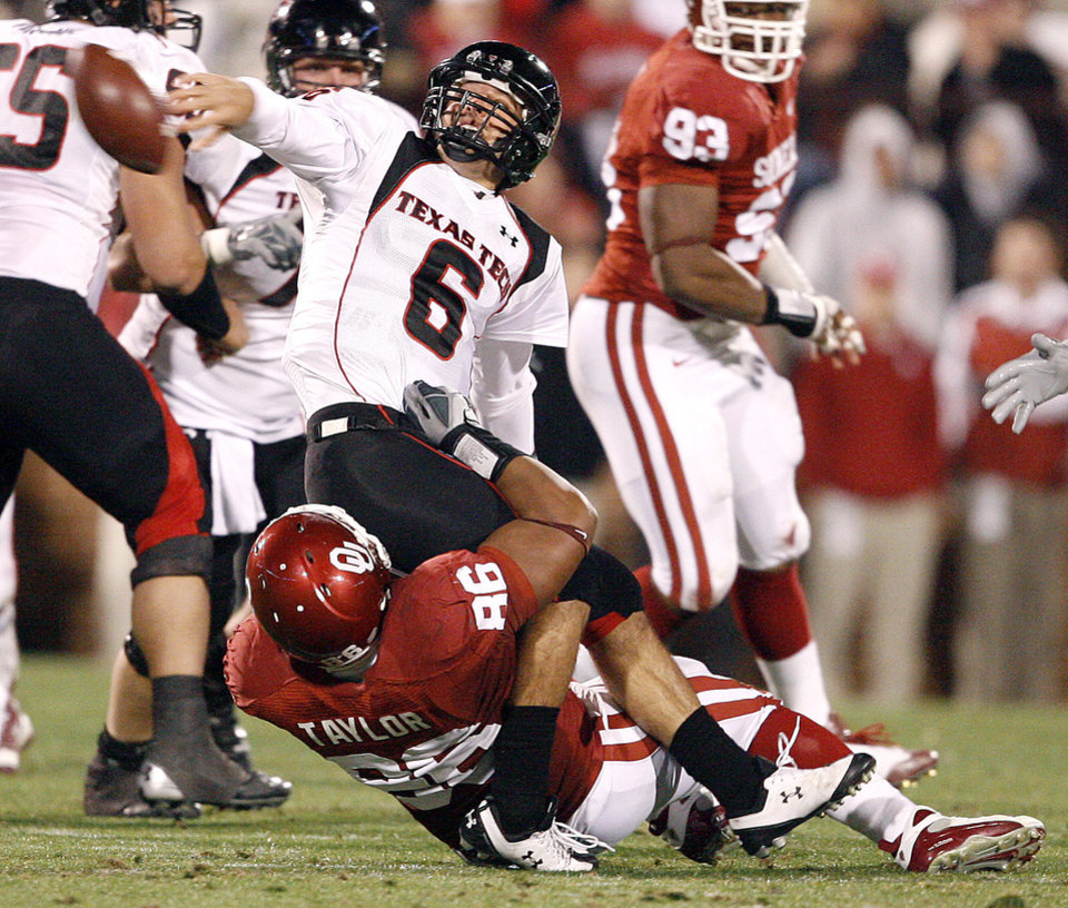 Photo - Graham Harrell of Texas Tech tries to get rid of the ball as OU's Adrian Taylor tries to bring him down during the college football game between the University of Oklahoma Sooners and Texas Tech University at Gaylord Family -- Oklahoma Memorial Stadium in Norman, Okla., Saturday, Nov. 22, 2008. BY BRYAN TERRY, THE OKLAHOMAN