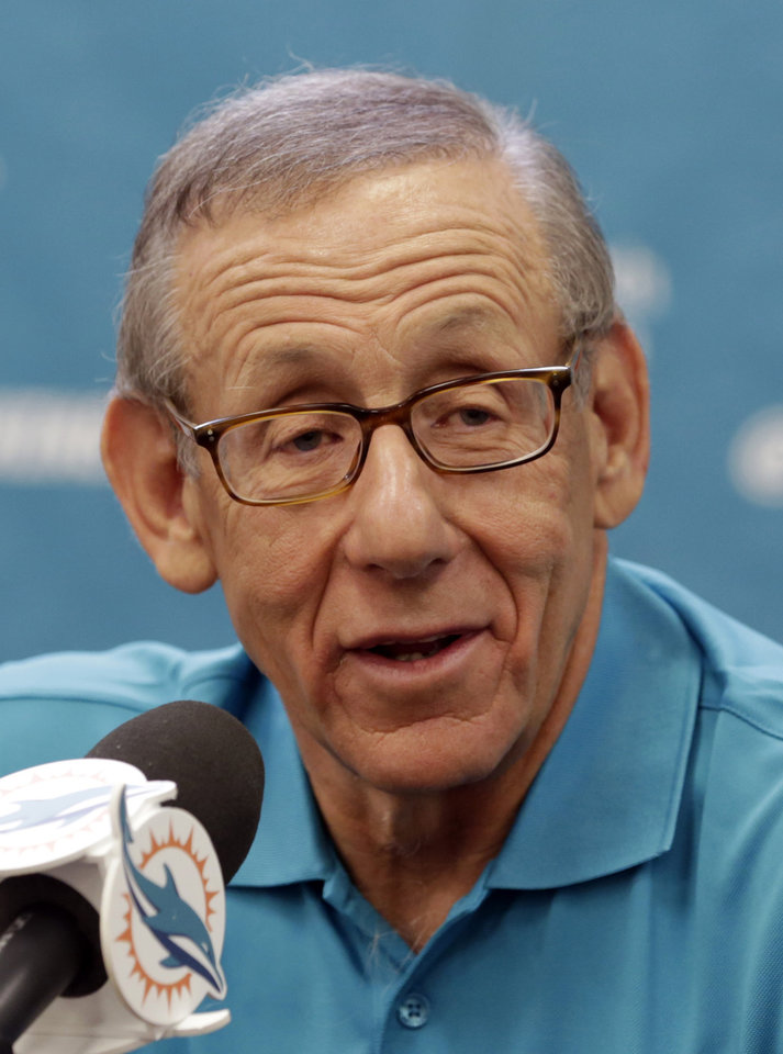 Photo - FILE - In this Aug. 7, 2013, file photo, Miami Dolphins owner Stephen Ross answers a question during an NFL football media availability in Davie, Fla. Now that the NFL knows the scope of the racially charged Dolphins bullying scandal, the league has been left to grapple with what its next steps should be. Ross wants his organization to lead the way to change the culture. (AP Photo/Alan Diaz, File)