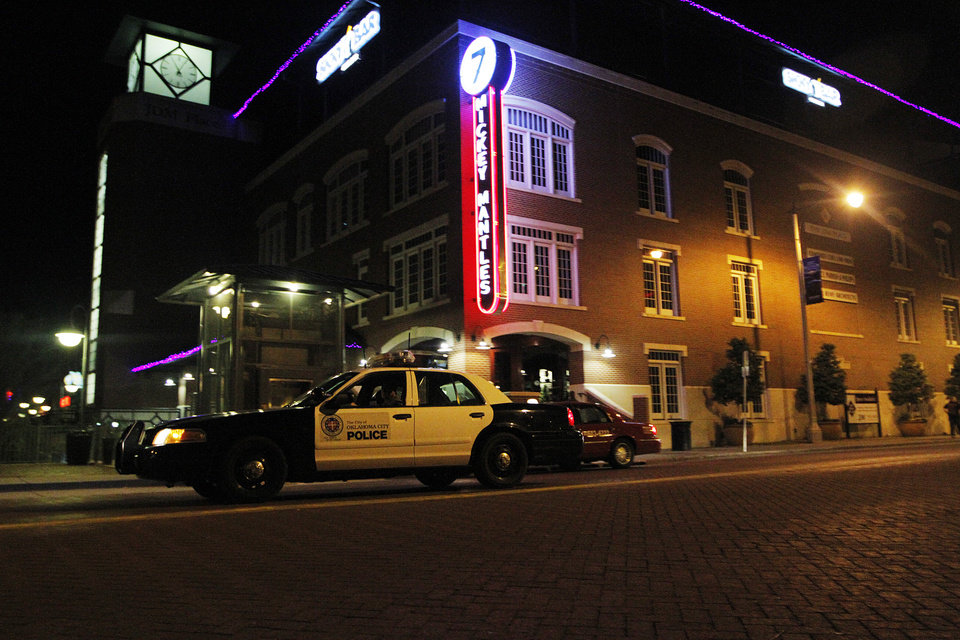An Oklahoma City police car partrols the Bricktown area in Oklahoma City, Saturday, March 24, 2012.  There have been several assaults near bars in Bricktown the last eight months.  Photo by Garett Fisbeck, For The Oklahoman