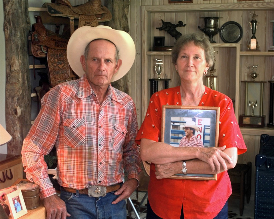 Clyde and Elsie Frost with photo of their late son Lane Frost.  <strong>DAVID MCDANIEL - ARCHIVE, THE OKLAHOMAN</strong>