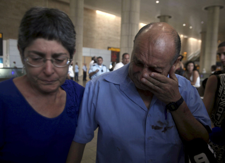 Photo -   A Israeli survivor from a bombing in Bulgaria that killed seven people on Wednesday, cries as he arrives at the Ben Gurion airport in Tel Aviv, Israel, Thursday, July, 19, 2012. The bombing was the latest in a series of attacks attributed to Iran that have targeted Israelis and Jews overseas and threatened to escalate a shadow war between the two arch-enemies. (AP Photo/Dan Balilty)