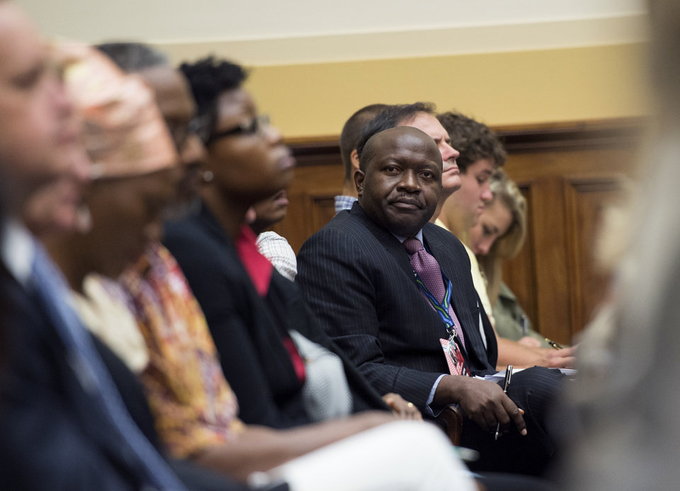 Photo - Augustine Kpehe Ngafuan, Liberia Minister of Foreign Affairs, looks out from his seat on Capitol Hill in Washington, Thursday, Aug. 7, 2014, during a hearing on the Ebola threat before the House Foreign Affairs Subcommittee on Africa, Global Health, Global Human Rights, and International Organizations. (AP Photo/Molly Riley)