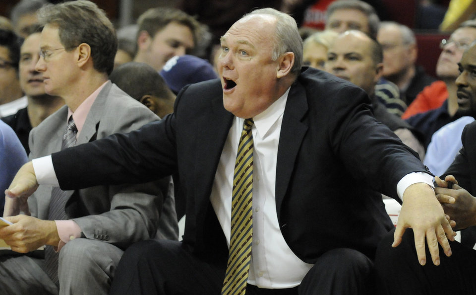 Photo - Denver Nuggets coach George Karl yells at a referee during the second half of an NBA basketball game against the Houston Rockets on Wednesday, Jan. 27, 2010, in Houston. The Nuggets won 97-92. (AP Photo/Pat Sullivan) ORG XMIT: HTR109