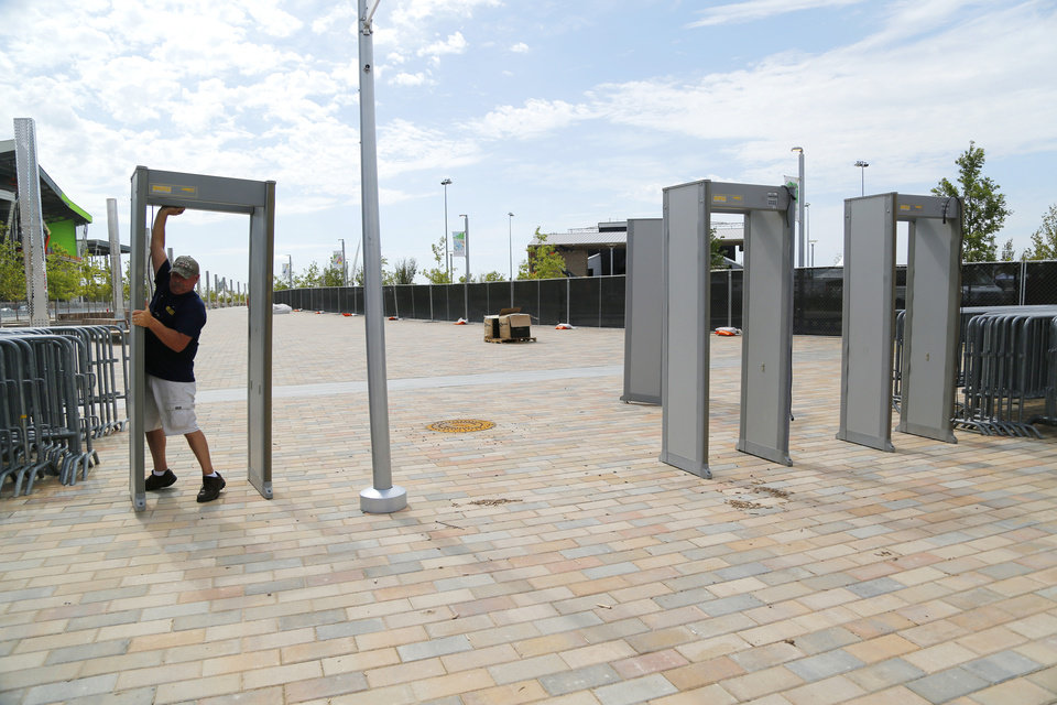 Photo - Setting up the metal detectors. Preparations are wrapping up for the opening night Kings of Leon concert to kick off the grand opening weekend of Scissortail Park Thursday, September 26, 2019. [Doug Hoke/The Oklahoman]