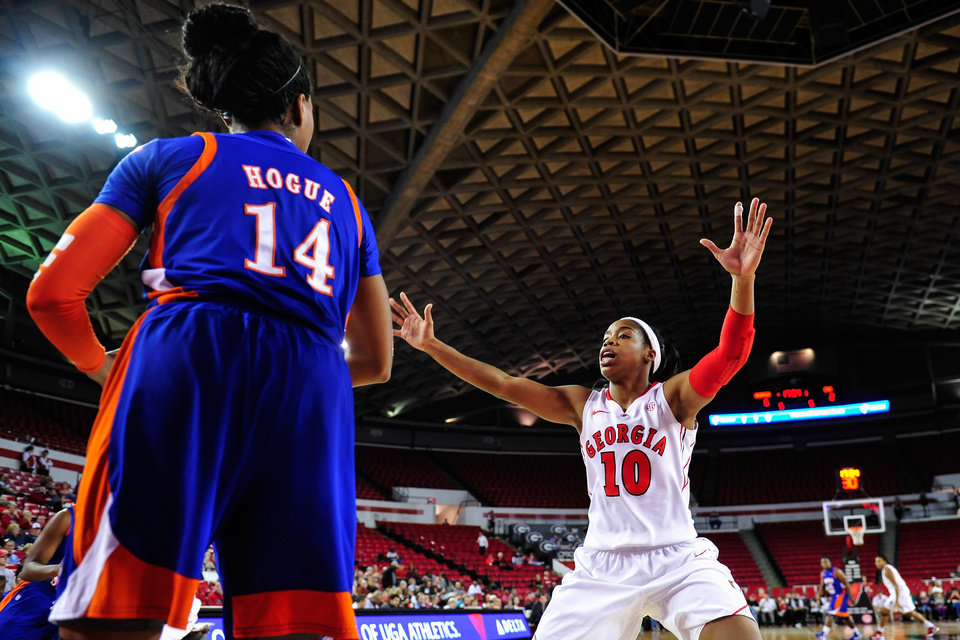 Photo -   Georgia guard Jasmine James (10) defends against Savannah State forward Erin Hogue (14) during the first half of an NCAA college basketball game in Athens, Ga., Tuesday, Nov. 20, 2012. (AP Photo/AJ Reynolds)