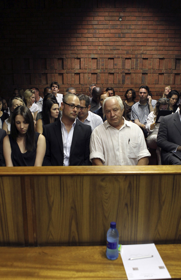 The family of Olympic athlete Oscar Pistorius, front row from left to right, sister Aimee, brother Carl and father Henke Pistorius, at the magistrate court in Pretoria, South Africa, Wednesday, Feb. 20, 2013. Oscar Pistorius arrived at the court building in a police car with a blue blanket covering his head Wednesday as prosecutors prepared to detail why they are charging him with premeditated murder in the shooting death of his girlfriend. Prosecutors want to show why he should be denied bail. Pistorius denies the charge, and said it was an accidental shooting. Pistorius is charged with premeditated murder for the Feb. 14 shooting death of model Reeva Steenkamp at his upscale home in the eastern suburbs of the South African capital, Pretoria. (AP Photo/Themba Hadebe)
