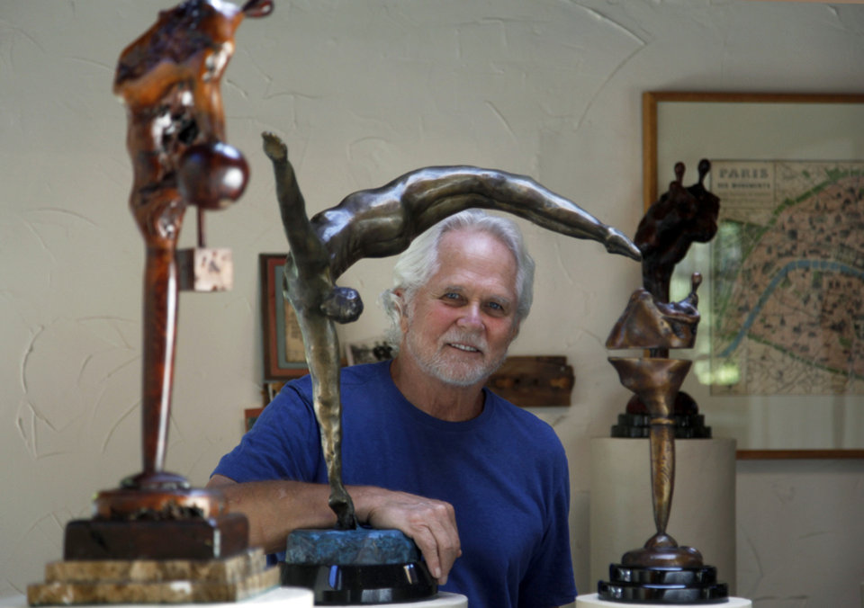 "In this Thursday, Sept. 18, 2012 photo, Tony Dow, actor, director and artist, poses with, from left, Adam's Rib, Half Twist and Waiting, at his home and studio in the Topanga area of Los Angeles. When it comes time to sitting down in a studio and carving out bronze and wooden sculptures inspired by the nature all around him, Wally isn't leaving it up to the Beav these days. Dow, who famously played the Beaver's older brother Wally on the classic 1950s-60s sitcom ""Leave it To Beaver,"" is carving out a name for himself in the art world these days, as an abstract artist. (AP Photo/Reed Saxon) ORG XMIT: CARS603 <strong>Reed Saxon - AP</strong>"