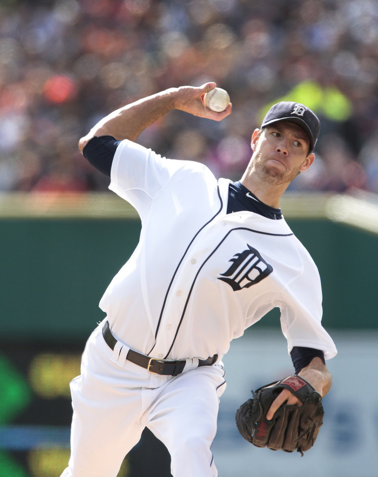 Detroit Tigers starting pitcher Doug Fister throws during the first inning of Game 2 of the American League division baseball series against the Oakland Athletics, Sunday, Oct. 7, 2012, in Detroit. (AP Photo/Duane Burleson)