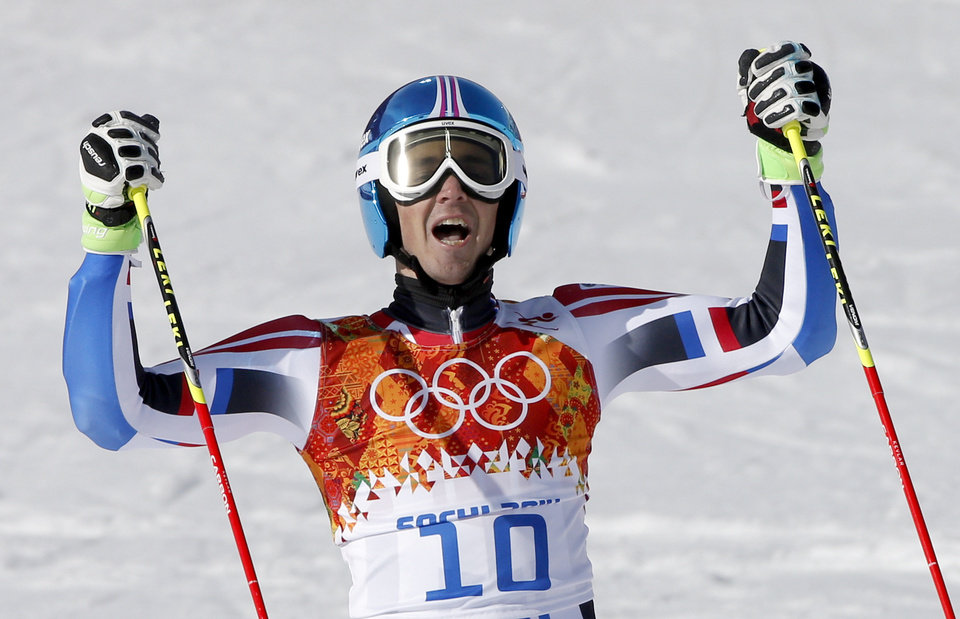 Photo - France's Steve Missillier celebrates after finishing the second run in the men's giant slalom at the Sochi 2014 Winter Olympics, Wednesday, Feb. 19, 2014, in Krasnaya Polyana, Russia.(AP Photo/Christophe Ena)